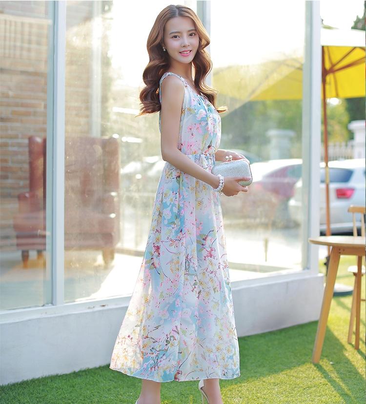 ชุดเดรสยาวสีชมพู แขนกุด คอกลม เอวยืด มีซับใน ผ้าชีฟอง ลายดอกไม้