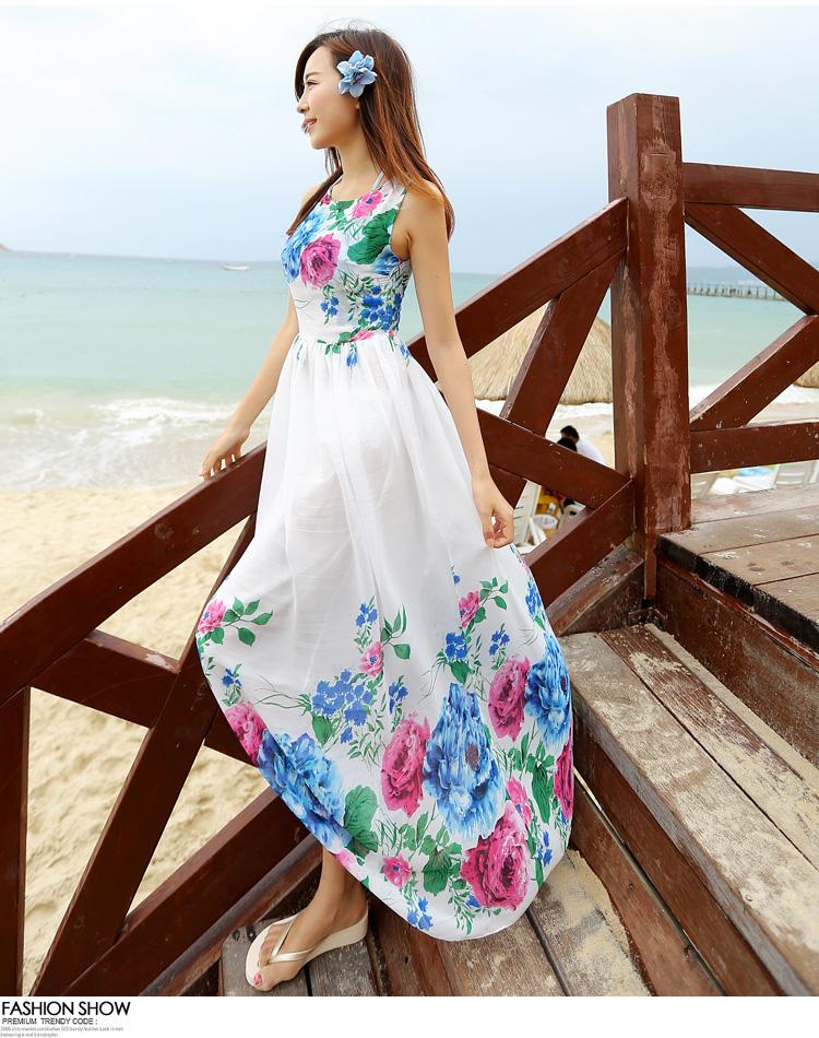 ชุดเดรสยาวสีขาว พิมพ์ลายดอกไม้สีน้ำเงิน ผ้าชีฟอง แขนกุด คอกลม ใส่ไปเที่ยวทะเล
