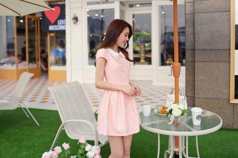 ชุดเดรสสีชมพู คอปก แขนสั้น กระโปรงทรงสุ่มเล็กๆ ปักลายดอกไม้ทั้งตัว ลุคสาวหวานสวยๆ น่ารักๆ ใส่ออกงาน ไปงานแต่งงาน
